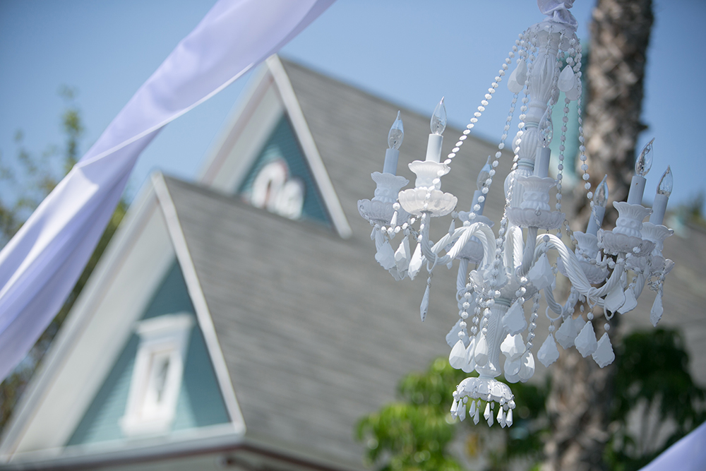 White chandelier wedding rentals