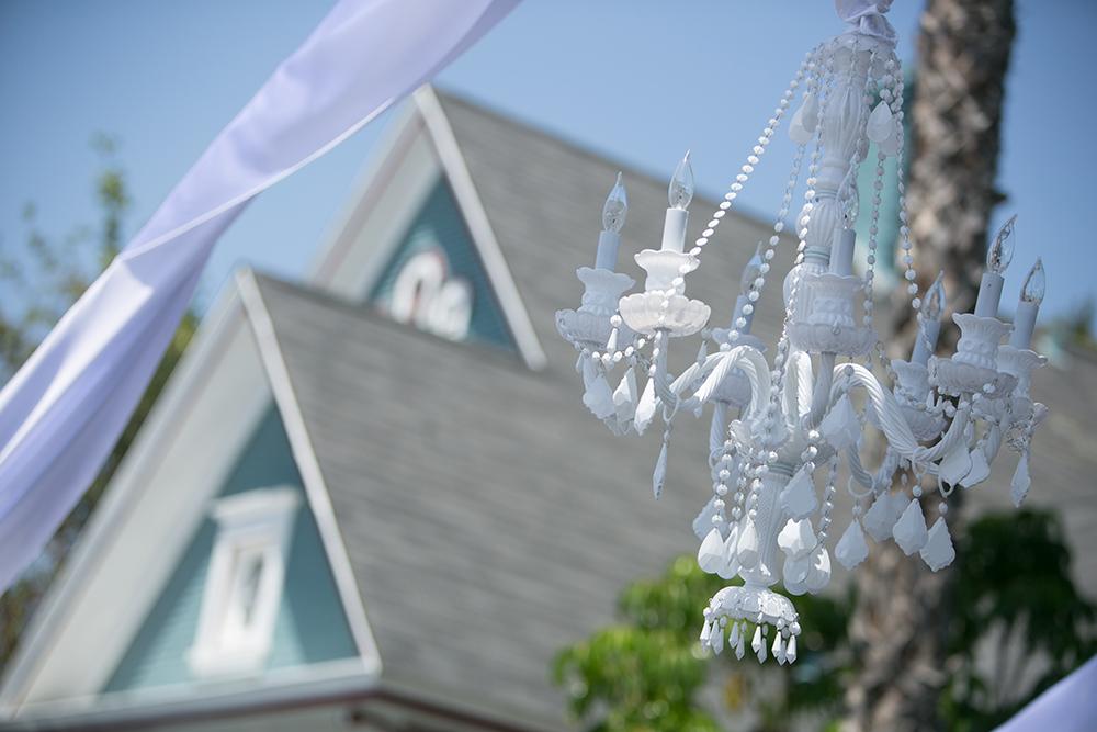 White chandelier wedding rentals